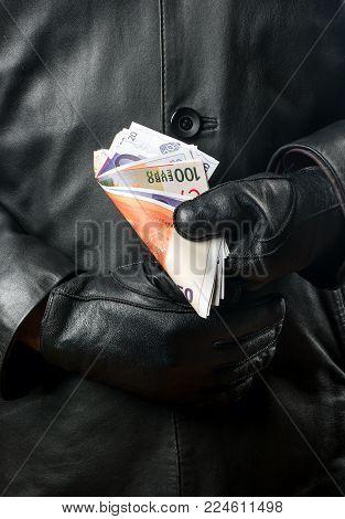 Bandit With Money In Hands