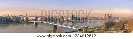 Panoramic view of Novi Sad, Serbia cityscape, Danube river and Petrovaradin fortress in the beautiful misty evening sundown poster