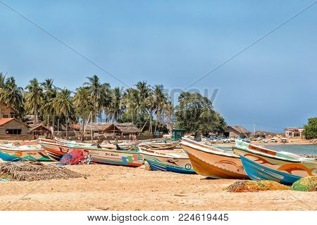 Kalpitiya, Sri Lanka - January 1, 2018. Fishing boats in traditional fishermen's village in Sri Lanka. Near the village of Kalpitia on the oceanfront there are many small fishing villages with traditional buildings