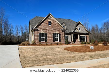 WATKINSVILLE, GEORGIA, USA - JANUARY 31, 2018: Home construction is booming at local counties in Georgia. Shown is a new constructed home for sale on January 31, 2018 at Watkinsville, Georgia.