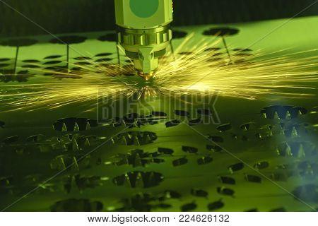 The fiber laser cutting machine cutting the sheet metal.The sheet metal cutting process by CNC fiber laser cutting.