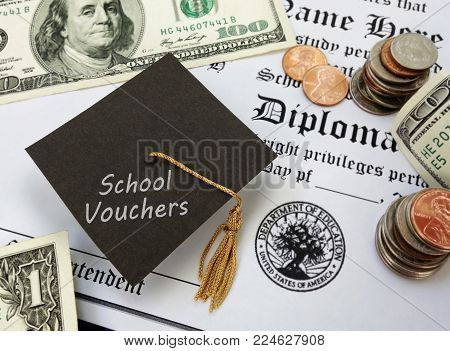 High school diploma with School Vouchers text on a graduation cap