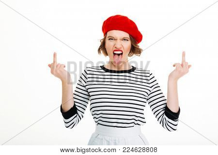 Photo of young angry displeased woman isolated over white background wall looking camera showing middle fingers.