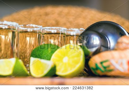 Close-up of several shots of traditional Mexican tequila with lime and salt, selective focus