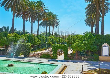 The Shady Green Garden Of Naranjestan Complex With Rows Of Palm Trees, Shady Aaleys, Fountains And I