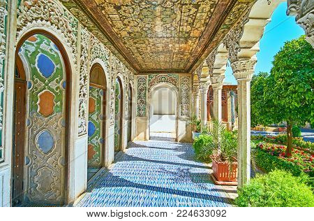 Shiraz, Iran - October 12, 2017: The Richly Decorated Covered Gallery Of Zinat Ol-molk Mansion Is Ne