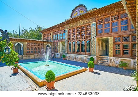 Shiraz, Iran - October 12, 2017: The Courtyard Of Zinat Ol-molk Mansion Is Occupied With Scenic Gard