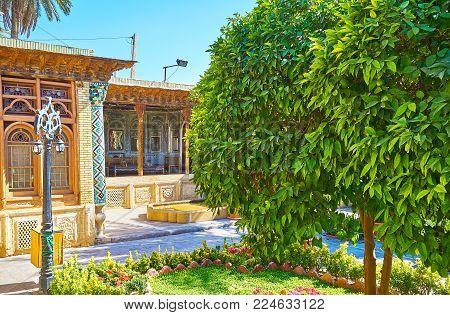 Shiraz, Iran - October 12, 2017: The Scenic Garden Of Zinat Ol-molk Mansion With Mirror Veranda On T