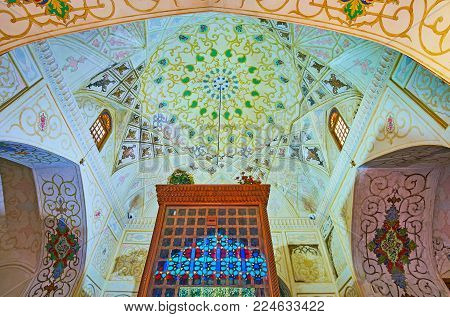 SHIRAZ, IRAN - OCTOBER 12, 2017: The  beautiful painted patterns on dome and walls of Imamzadeh Jalal Addin shrine of Nasir Ol-Molk complex, on October 12 in Shiraz.