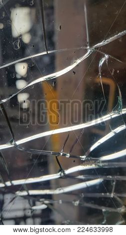 the broken glass window . shards of glass.