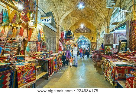SHIRAZ, IRAN - OCTOBER 12, 2017: The carpets are the visit card of Persia, Vakil Bazaar offers wide range of these goods in different styles, sizes and prices, on October 12 in Shiraz.