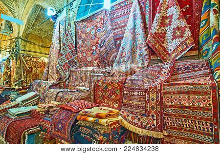 The Persian carpets are popular gift from Iran, Vakil Bazaar of Shiraz offers large amount of kilims and rugs, Iran.