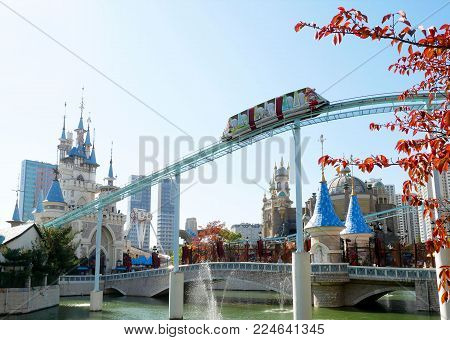 Seoul, South Korea - october 30, 2017: Lotte World amusement theme park and red leaves in autumn season, a major tourist attraction in Seoul, South Korea.