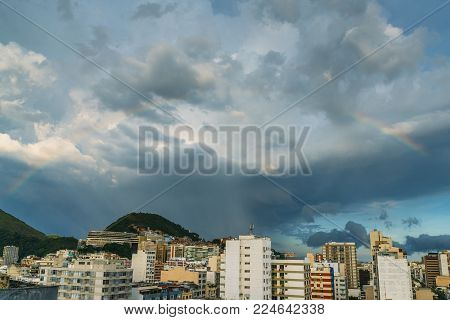 Beautiful rainbow above Ipanema in Rio de Janeiro, Brazil. The Cantagalo favela is visible at the far end of the image in the centre
