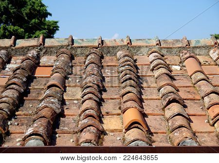Roof With Old And New Tiles