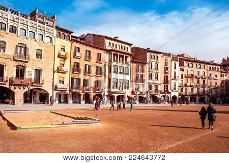 VIC, SPAIN - DECEMBER 29, 2017: A view of the Placa Major square, with its emblematic buildings with porches, which is the most popular landmark in the city