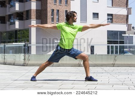 Young Athlete Doing Stretching Exercise