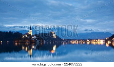 night scenery at Bled lake with church on island . Dramatic , picturesque fall scene. Popular tourist attraction. Bled town, Slovenia, Europe.