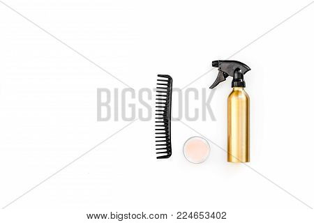 Professional hairdressing tools in beauty saloon. Combs, spray on white background top view.