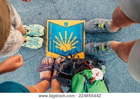Bilbao, Spain - July 11, 2017:  Three pairs piligrims feet on the start of the Camino de Santiago or