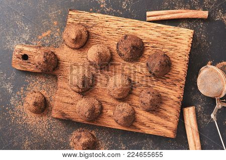 Delicious candy truffles sprinkled with cocoa powder ,top view