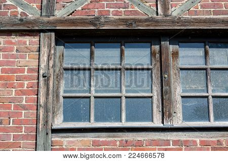 close-up on an old half-timbered colorful window