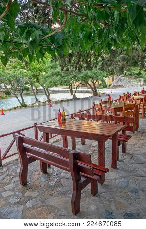 Tables And Chairs Of Street Cafe Under Trees