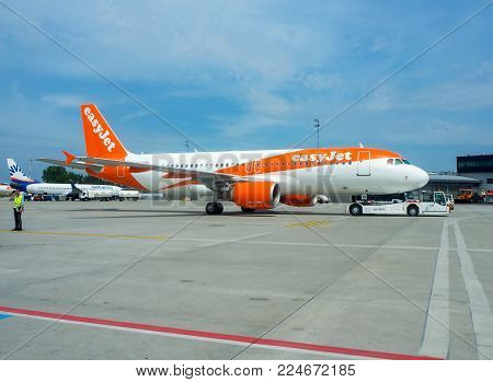 Krakow, Poland - June 27, 2017: EasyJet aircraft Airbus a320 with a pushback tug on the International Balice airport in Cracow