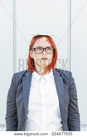 Business Concept Of Success And Negotiation. Woman Boss, In Suit And Glasses With Tablet On Head And