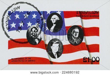 USA - CIRCA 1976: A stamp printed in USA shows an American Flag flying in the breeze, with Presidents of USA , circa 1976