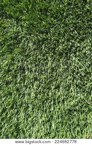Outdoor artificial green grass turf textured background