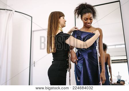 Female Fashion Designer Designing Clothes In Her Fashion Design