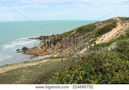 Vegetation, sun, sand, rocks and ocean in Jericoacoara - Brazil