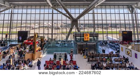 London, England, April 20, 2016: Heathrow Terminal 5 is an airport terminal at Heathrow Airport. Opened in 2008, the main building in the complex is the largest free-standing structure in the UK
