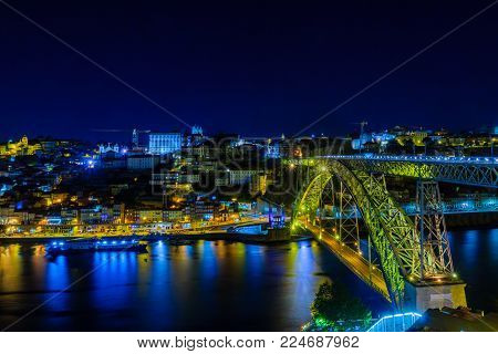 Night view of The Dom Luis I Bridge, and the Ribeira (riverside), in Porto, Portugal poster