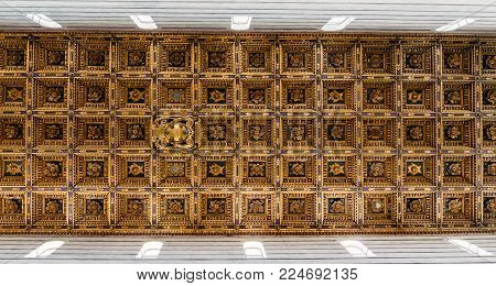 Pisa, Italy - Oct 28, 2017: Golden roof of Pisa Cathedral in Italy, which is a medieval Roman Catholic cathedral dedicated to the Assumption of the Virgin Mary
