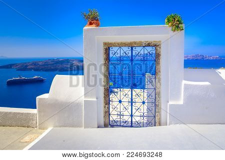 Oia, Santorini, Greece.Decorative patterned doorway to a balcony overlooking the mediterranean sea. Thira, Santorini, Greece island