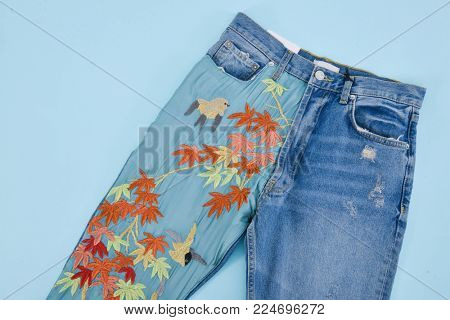 Embroidered flowers ,bird jeans –blue  background
