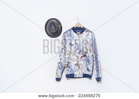 jacket with floral print with hat on hanging
