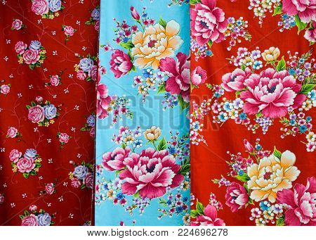 Row of colorful floral fabric on hanging