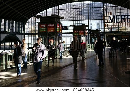DARMSTADT, GERMANY - OCTOBER 31: The entrance hall and the roof vault of the Darmstadt main station carried by steel girders with travelers on October 31, 2017 in Darmstadt.