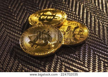 Three Virtual Shiny Coins Bitcoins Heap On Dark Background Close Up Of Real
