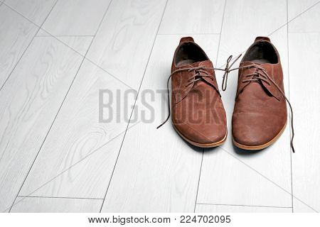 Pair of shoes with laces tied together. April fool's day celebration