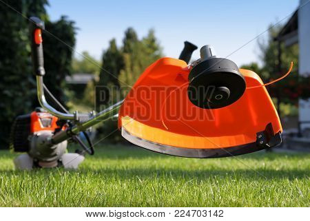 Brush cutter handles with the grass in the court yard