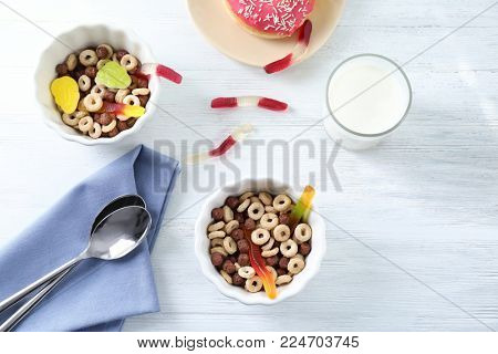 Cereal with gummy worms in bowls. April fools food