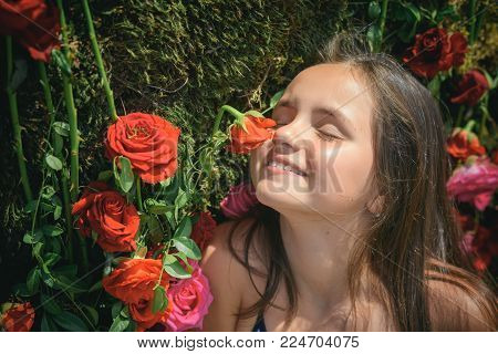 Florist girl in florist shop. Florist child on flower arrangement, decor, design.