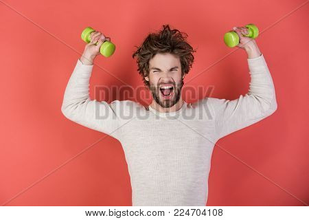 Sportsman, shouting man on red background. Morning exercise and healthy lifestyle. Man workout after wake up, fitness. Athlete in underwear training with barbell. Energy and sport success, coach.