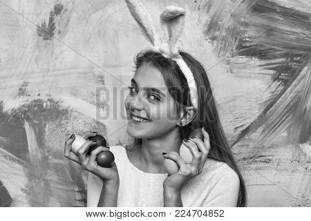 Happy Easter Girl In Pink Bunny Ears With Colorful Painted Eggs, Has Long Blonde Hair And Adorable S