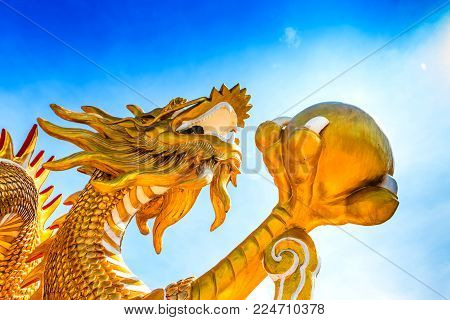 Statue Of Gold Dragon In Asian Temple, Blessing And Lucky On Chinese New Year