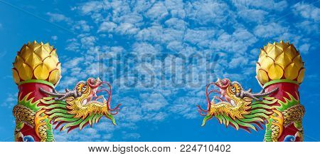 Statue Of Gold Dragon In Asian Temple, Blessing And Lucky On Blue Sky